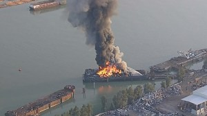 Surrey barge fire sends black smoke into skies above Vancouver