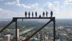 Edmonton ironworkers with nerves of steel pose atop Stantec skyscraper