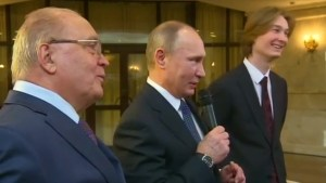 Vladimir Putin sings Soviet space song with Russian students