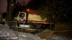 Garbage truck crashes through homes