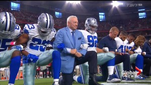 Dallas Cowboys lock arms, take knee prior to national anthem on Monday Night Football