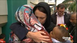 New Zealand PM Jacinda Ardern lays wreath at mosque, embraces mourners of Christchurch victims