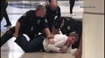 Doctor says he was making a point about police brutality in viral airport arrest video