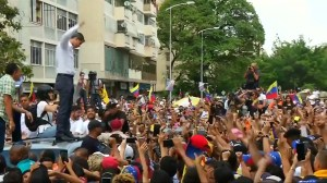 Venezuela's Guaido spurs supporters on at massive opposition rally