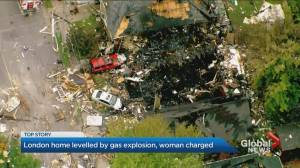 Investigators survey the damage after massive explosion in London, Ont.