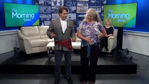Bill Welychka gets a lesson in belly dancing