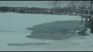 Snowmobiler rescues himself from lake