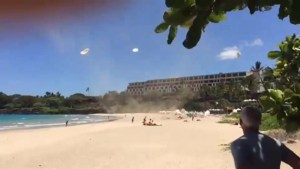 Dust devil spoils day at the beach for Hawaiian sun seekers