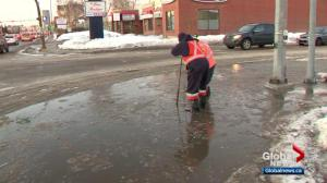 Calgary crews working hard to clear clogged drains and pooling water