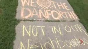 Sidewalk chalk makeshift memorial lines sidewalk in Danforth neighbourhood after mass shooting