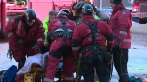 Woman falls into maintenance hole after electrical explosion in downtown Edmonton