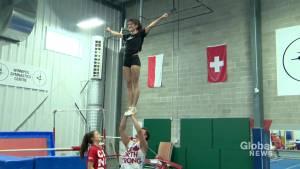 Manitoba cheerleaders demonstrate routine