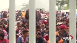 Caravan at Mexico-Guatemala border shrinks as migrants cross through, hoping to reach U.S.