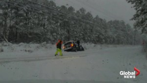 Video shows cars stuck on roads in snow-covered North Carolina