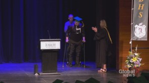 Paralyzed Calgary graduate walks across the stage to receive diploma