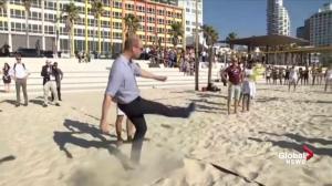 Israeli beach goers teach Prince William game of footvolley