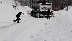 Quebec snow plow struggles to navigate ice and snow gripping parts of province