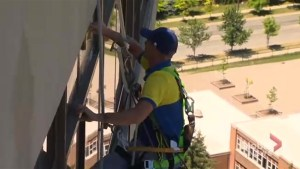 Window cleaner swoops in to save woman, 50, collapsed on balcony
