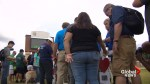 People stand for moment of silence in honour of victims of Santa Fe school shooting
