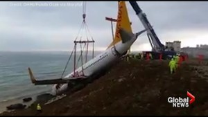 Large crane used to remove plane which skidded off runway in Turkey