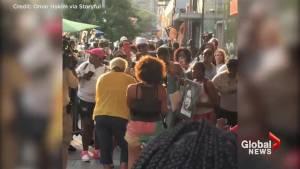 Fans dance to Aretha Franklin's 'Rock Steady' outside Apollo Theatre
