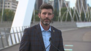 Iveson interrupted by loud vehicles while speaking at Walterdale Bridge grand opening
