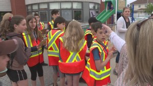 Students monitor traffic in front of Kirkland school