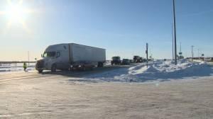 Convoy: Hundreds of big rigs pass through Winnipeg (01:14)