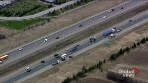 Man dead after being struck by cement truck on side of highway in Aurora