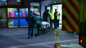 Injured person taken from ambulance following explosion in Manchester