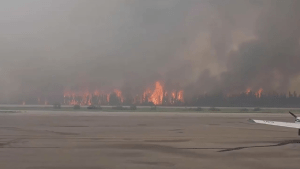 Raw:  Wildfire burning in La Ronge