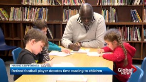 Retired football player Ollie Dunlap devotes his time reading to children