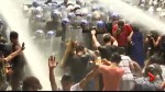 Anti-Trump protesters shot with water cannons during Manila demonstration