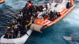 Dramatic video shows rescue of migrants from sinking boat