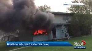 Man who pulled people from burning townhouse hailed a hero
