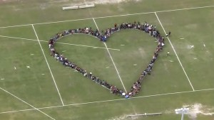 U.S. students form human heart  during protest against gun violence