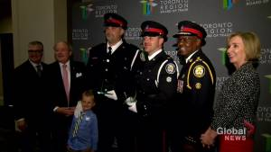 Toronto cops who saved 2 men trapped in elevator during flash flood named 2018 officers of the year