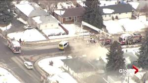 Calgary fire crews transport patient from working house fire