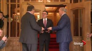 Andrew Weaver and John Horgan deliver agreement to Government House