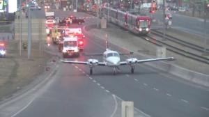 Small plane lands on busy street near downtown Calgary
