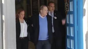 Harvey Weinstein heads to court in handcuffs