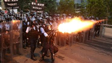 Chaotic Video Shows Hong Kong Police Using Batons Tear Gas Against Protesters