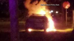 Empty cop car set on fire in Florida; note referencing police shootings, BLM found