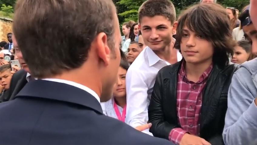 World News, France's Macron admonishes teenager; video goes viral