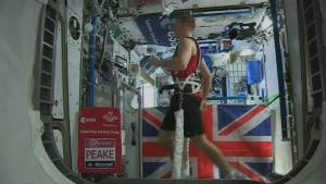 Astronaut Tim Peake crosses London Marathon finish line from space