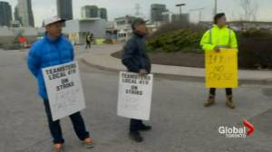 Food terminal workers block produce trucks in protest over wages