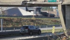 Truck hits 152nd Street overpass
