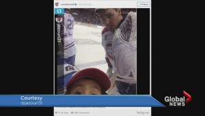 Price takes on-ice selfie with young fan