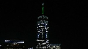 One World Trade Center lights up in green after Trump opts out of Paris climate agreement