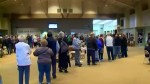 Long lineups reported at voting stations across America